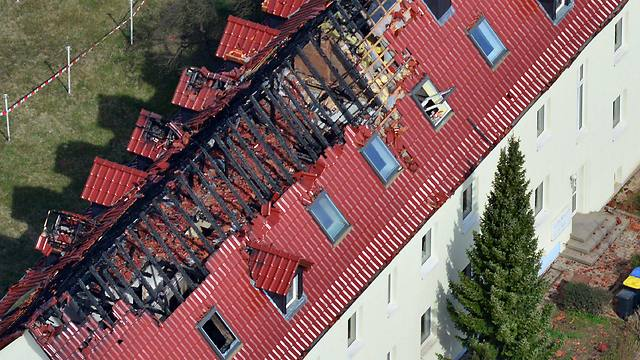 An aerial view of the house with a burned-out roof truss in Troeglitz, Germany (Photo: EPA)