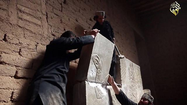 Militants destroying a relief (Photo: AFP)