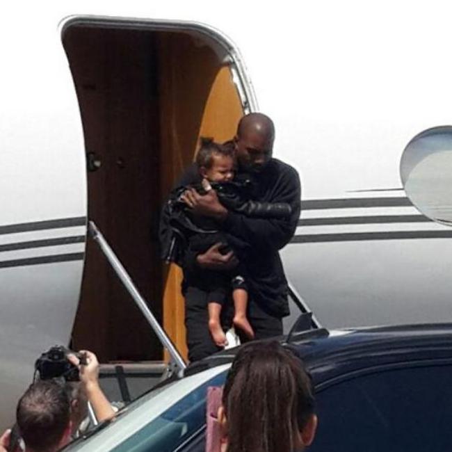 Kanye West holds North West as he lands in Israel along wtih wife Kim Kardashian. (Photo: Tamar Shiner)