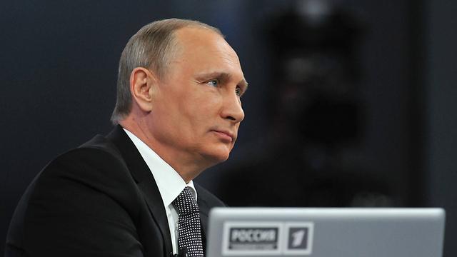 """גוף בוררות בינלאומי פסק שרוסיה צריכה לשלם 50 מיליארד דולר למשקיעים בחברת הנפט """"יוקוס"""". פוטין (צילום: AP)"""