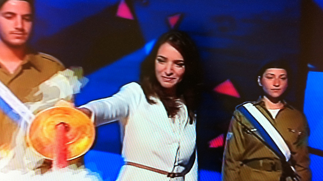 Lucy Aharish lights Independence Day torch. Refusing to play by the rules of the herd and be part of the hatred campaign
