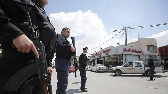 Palestinian policemen patrol Azariyeh in the West Bank (Photo: AP)