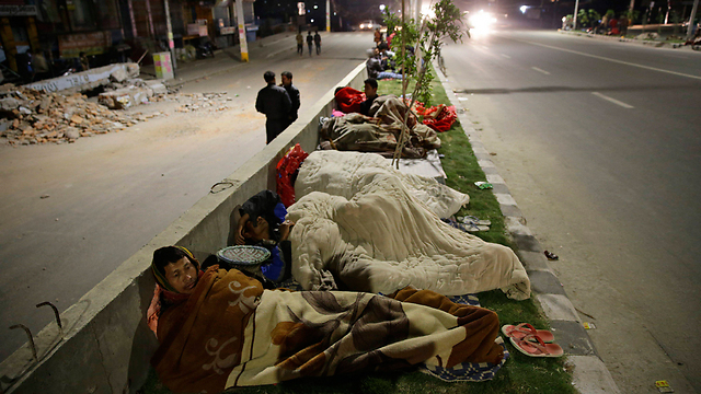 People sleep on a street in Katmandu (Photo: EPA) (Photo: EPA)