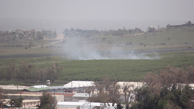 Shells fired in Syria falling on the Israeli side of the border (Photo: Eli Segel)