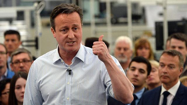 """הציע לקיים משאל עם בשאלת פרישה מהאיחוד האירופי. רה""""מ דיוויד קמרון מהשמרנים (צילום: EPA)"""
