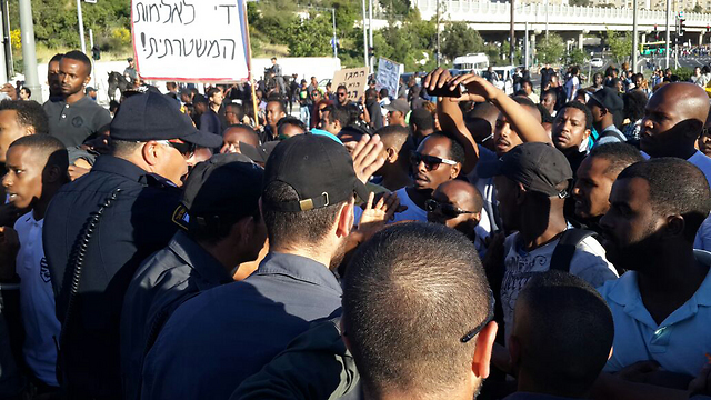 Ethiopian protestors face police. 'We are not transparent black people. We are citizens of the State of Israel just like you' (Photo: Ofer Meir)
