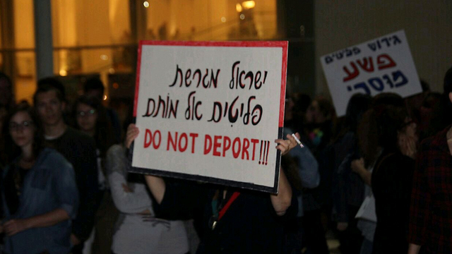 A Tel Aviv protest against the deportation of asylum seekers. The poster reads: 'Israel is expelling refugees to their deaths' (Photo: Eli Segal)