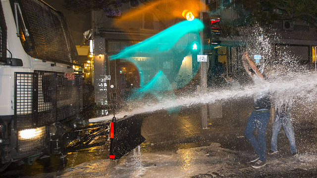 Police use water cannon during heavy clashes with protestors (Photo: AFP)