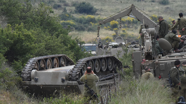 Armored personnel carrier turns over in Golan Heights durig IDF training. (Photo: Avihu Shapira)