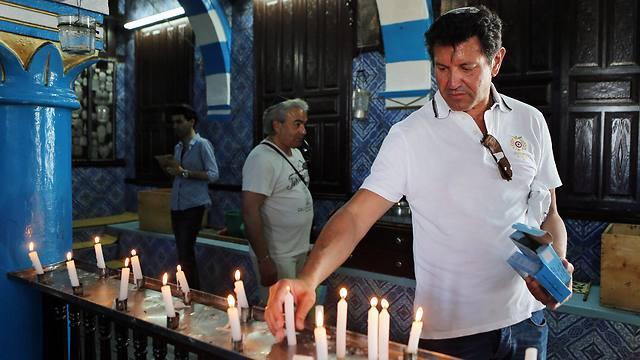A Jewish visitor lights a candle at the ancient Ghriba Synagogue (Photo: EPA)
