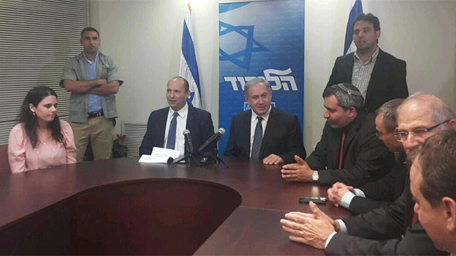 Netanyahu with Bayit Yehudi representatives, including his new justice minister, Ayelet Shaked (L)