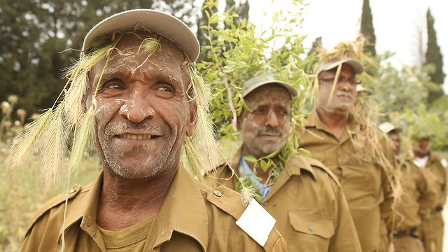 Combat ready. The fathers get a taste of camouflage. (Photo: Elad Gershgoren)