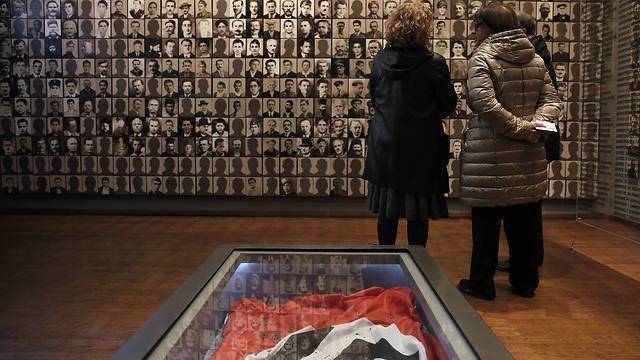 Visitors look at portraits of victims at the Holocaust Museum in the town of Kalavryta, western Greece (Photo: AP)