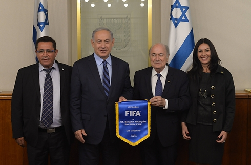 From left: Israel soccer federation chair Ofer Eini, Benjamin Netanyahu, Sepp Blatter and Culture and Sports Minister Miri Regev (Photo: GPO)