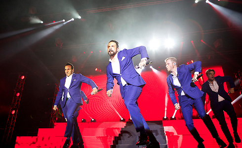 The Backstreet Boys performing their signature dance moves (Photo: Orit Pnini)