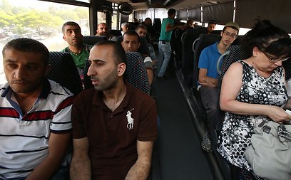 Palestinian and Israeli passengers on bus to Ariel, Wednesday. The bleeding conflict can only be solved by making peace on the ground, not through documents detached from reality (Photo: Shaul Golan)