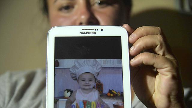 נמצא קבור בבוץ. התינוק חוסט דיאס (צילום: AFP) (צילום: AFP)