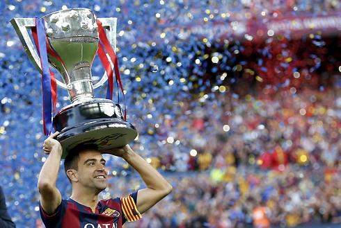 המעוטר ביותר בתולדות ברצלונה. צ'אבי (צילום: רויטרס) (צילום: רויטרס)