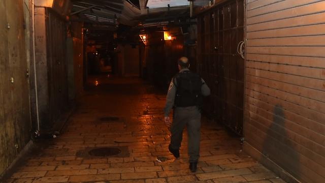 Police in the Old City Saturday night near the scene of the attack. (Photo: Gil Yohanon) (Photo: Gil Yohanon)