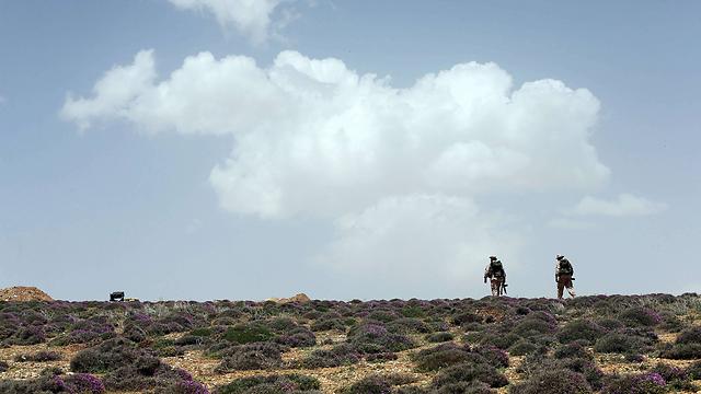 חיילי חיזבאללה בהרי קלמון. המעברים עם לבנון עדיין בשליטת אסד (צילום: AFP) (צילום: AFP)