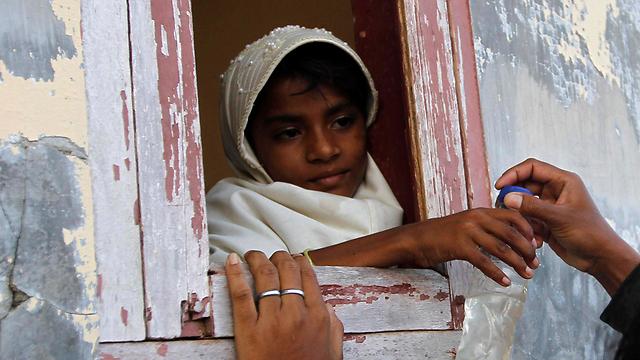 בת המיעוט המוסלמי הרוהינגי באינדונזיה (צילום: רויטרס)