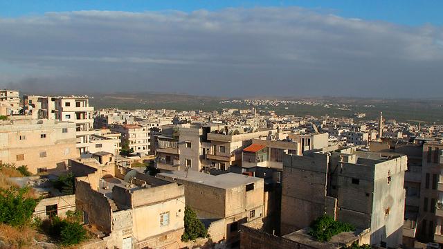 אריחא בידי המורדים (צילום: רויטרס) (צילום: רויטרס)