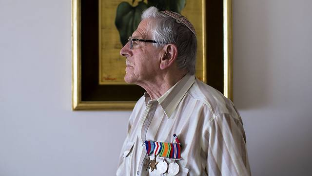 British Jewish World War II veteran Norman Cohen who landed on the beaches of Normandy on D-Day, poses for a photo at his home in Jerusalem (Photo: AP)