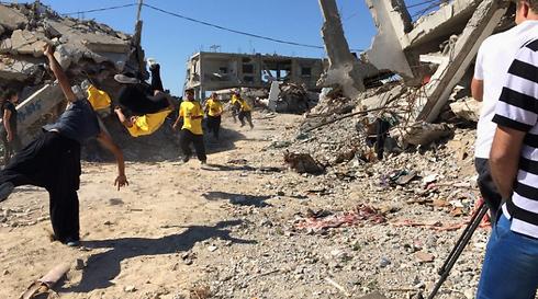 Kids play amoung rubble (Photo:CNN)