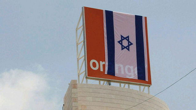 Israeli flag draped over Orange sign by protesters (Photo: Ido Erez)
