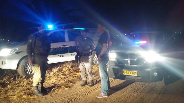 Authorities search for the fallen rocket Saturday night. (Photo: Bar'el Ephraim) (Photo: Bar'el Ephraim)