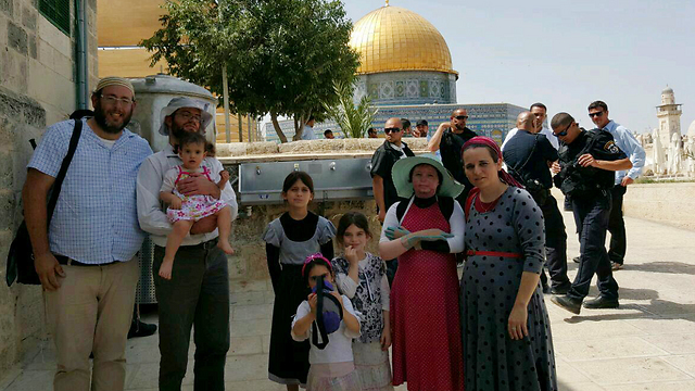 Ayla (in the red dress) with her family on the Temple Mount (Photo: Gilad Harari)