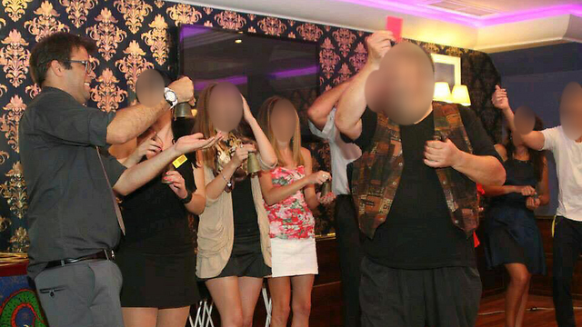 Hazan allegedly in the company of escorts at a Bulgaria casino.