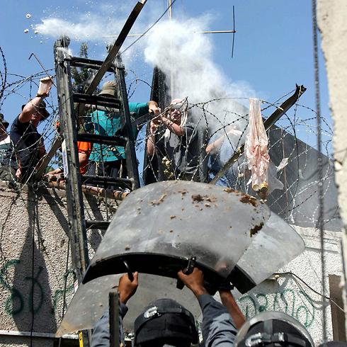 Clashes during the evacuation of Homesh (Photo: Amit Shabi)