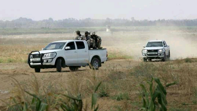 An armed Hamas patrol on the new border road.