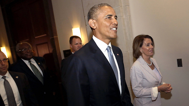 President Obama arriving to urge Congress members such as Nancy Pelosi (R) to back the agreement (Photo: Reuters)