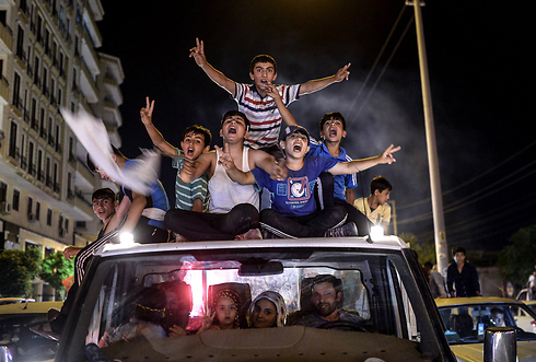 הכורדים חוגגים את ההישג המדהים שלהם (צילום: AFP) (צילום: AFP)