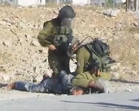 IDF soldiers arresting Palestinian demonstrator