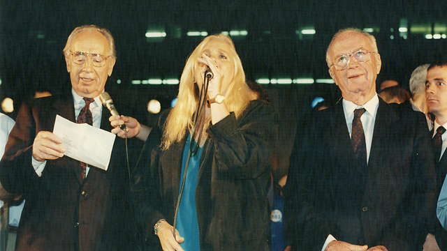 L to R: Peres with singer Shulamit Aloni and Rabin singing 'A Song for Peace' at the peace rally in which Rabin was murdered (Photo: Michael Kremer)