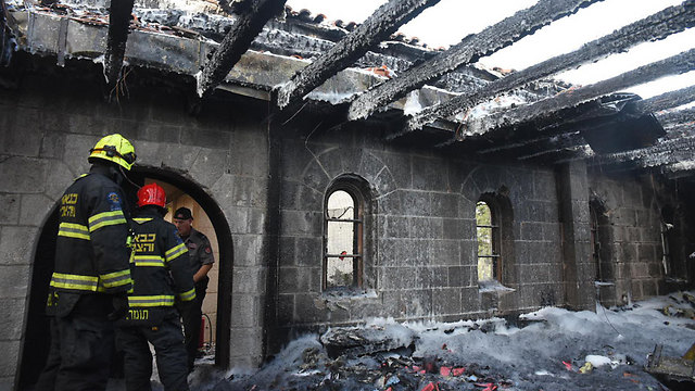 The settler rejoiced at the burning of the Church of Loaves and Fishes (Photo: Avihu Shapira)