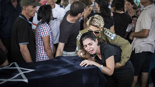 The funeral for 4 year old Daniel Triggerman killed by a mortar fired from a UN school (Photo: Gettyimages)
