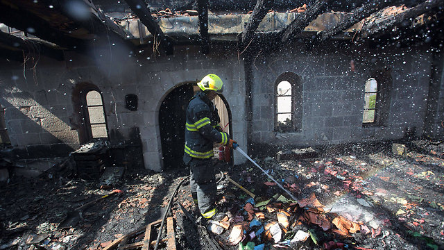 Arson at the Church of Multiplication in Tiberias (Photo: AFP)