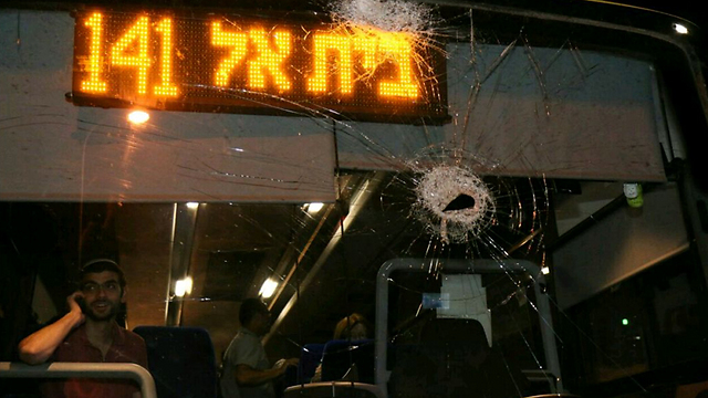 The bus damaged by rocks. (Photo: Tazpit News Agency) (Photo: Tazpit News Agency)