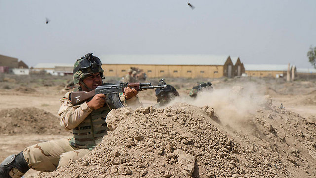 US troops training with Iraqi troops (Photo: Reuters)
