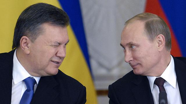 פוטין וינוקוביץ'                                      (צילום: AFP) (צילום: AFP)