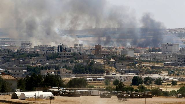 Flames engulf Kobani this during the Islamic State attack as seen from the Turkish border. (Photo: Reuters) (Photo: Reuters)