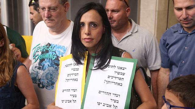 מפגינים בתל אביב (ארכיון) (צילום: מוטי קמחי) (צילום: מוטי קמחי)