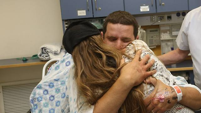 Yair Hoffer with his wife at Shaare Zedek Medical Center (Photo: Gil Yohanan)