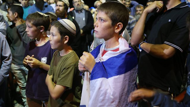 Young boys at the protest near the site where Malachi Rosenfeld was killed (Photo: Alex Kolomoisky)