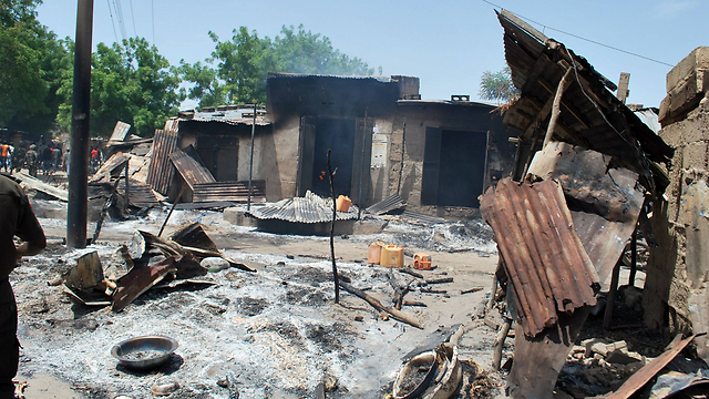 Homes in a Nigerian village, burned down by Boko Haram. Over 100,000 children become refugees every month (Photo: AFP)