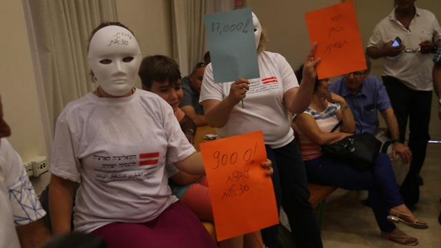 Protesters at the press conference (Photo: Moti Kimchi)